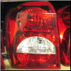 OEM Dodge 2008 - 2010 Caliber Tail Light, Driver Side (SKU: 09DodgeCal-Left-Tail)