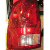 OEM Dodge 2009 - 2011  Ram Tail Light, Driver Side (SKU: 09DodgeRam-Left-Tail)